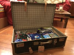 More Tips to avoid holiday stress: trunk neatly organized with gift wrap & ribbons